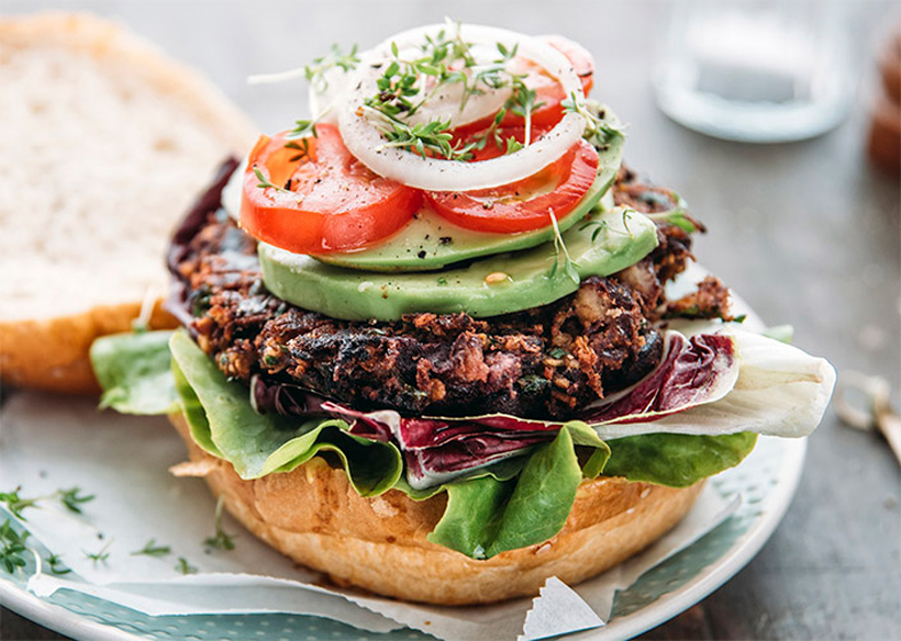 Black bean burger covered in delicious, healthy toppings.