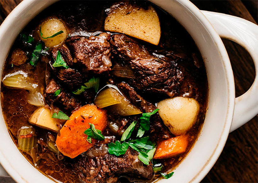 Hot boeuf bourguignon in a bowl.